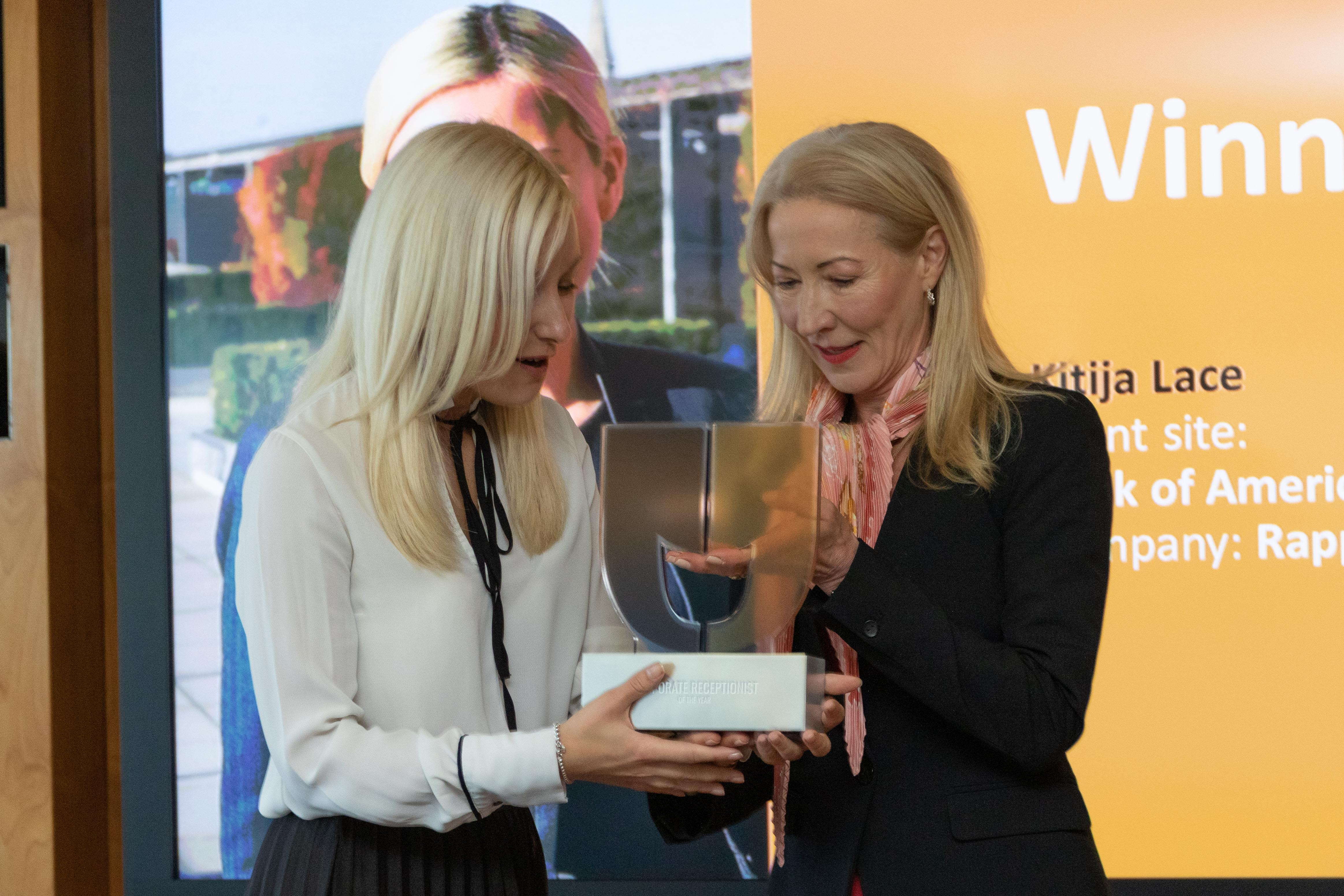 Kitija Lace receives the trophy for Corporate Receptionist of the Year