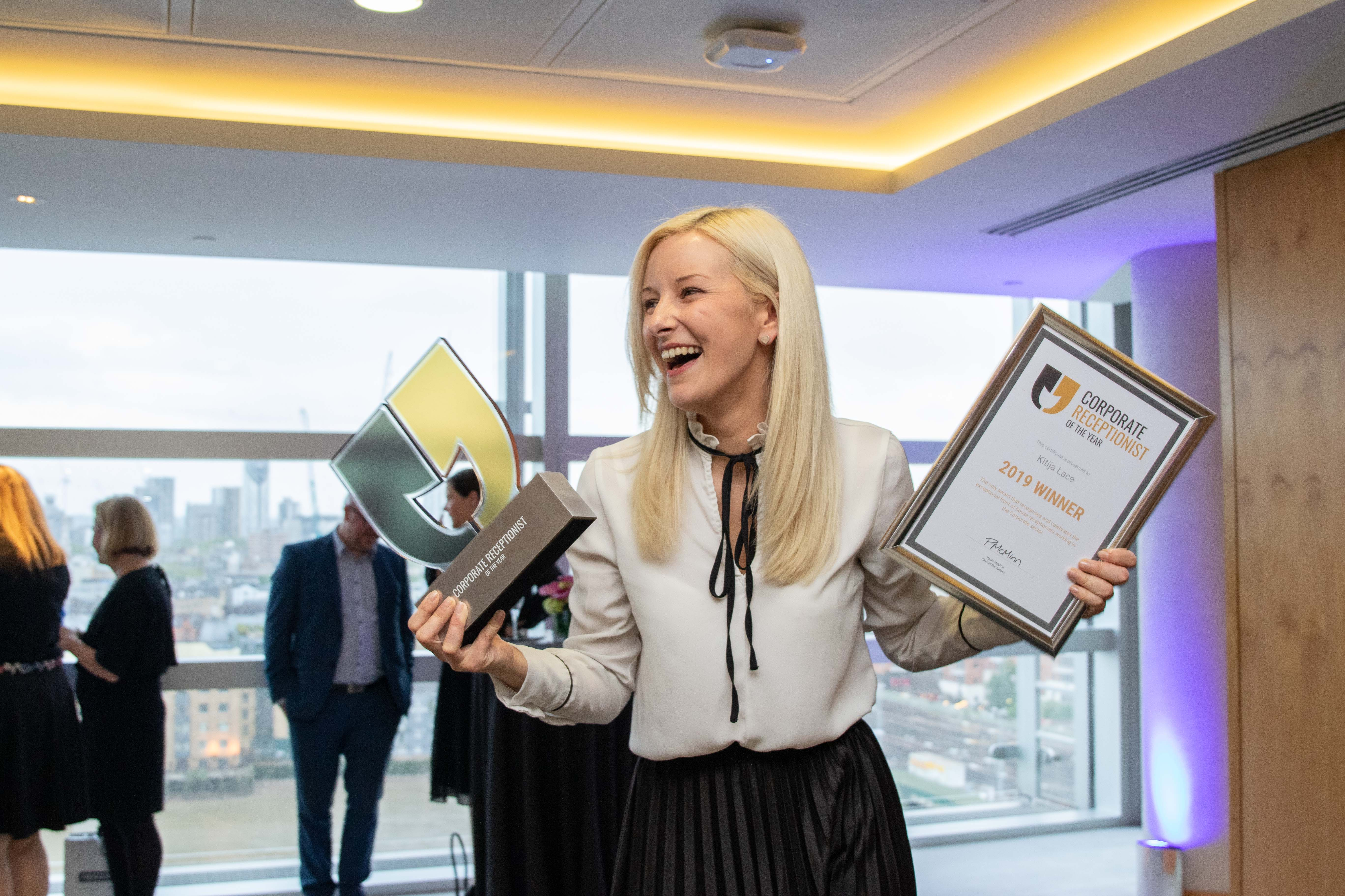 Winner, Kitija Lace laughing with her awards